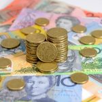 Australian dollars in Sydney, Friday, Jan. 15, 2016. (AAP Image/Joel Carrett) NO ARCHIVING
